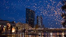 The Grand Rapids city skyline at night filled with lanterns from ArtPrize.