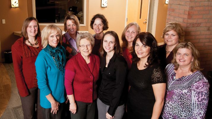 Dr. Laura Champion with the staff of Calvin's health services.