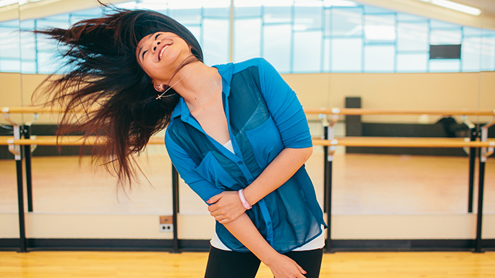 Student dancing in Calvin dance studio